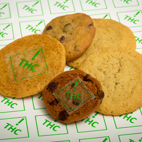 cookies with THC symbols on them in green