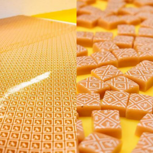 caramels embossed with white THC symbols