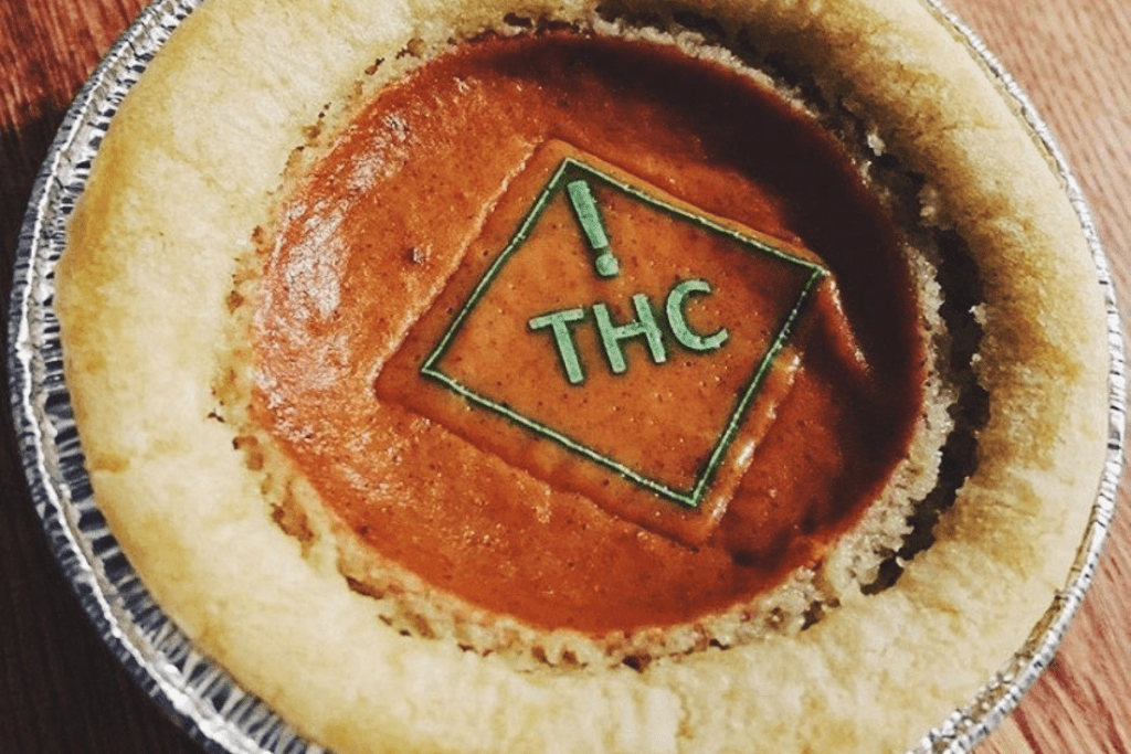 pumpkin pie with green thc symbol on top