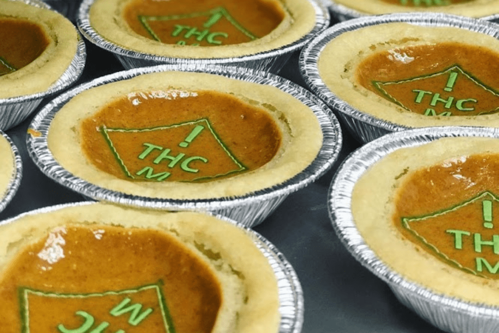 pumpkin pies with green thc symbol targets on top