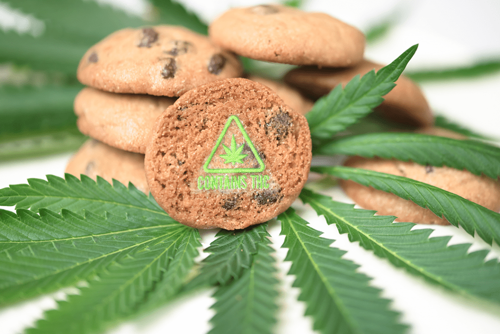 green contains THC symbol target on cookies with cannabis leaves
