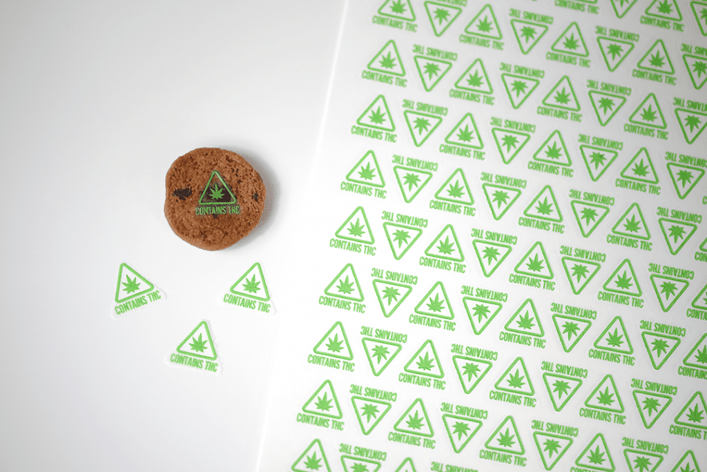 green contains THC symbol target on cookies next to sheet of targets